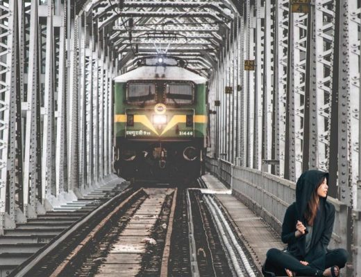 Woman in front of moving train